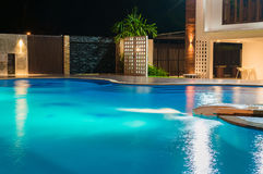 Swimming pool at a luxury Caribbean, tropical resort at night, d Royalty Free Stock Photo