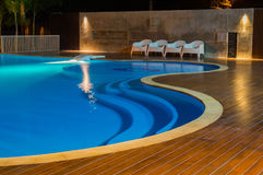 Swimming pool at a luxury Caribbean, tropical resort at night, dawn time. Stock Photo