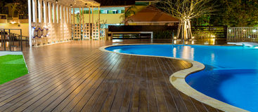Swimming pool at a luxury Caribbean, tropical resort at night, dawn time. Royalty Free Stock Photography