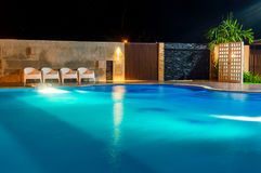 Swimming pool at a luxury Caribbean, tropical resort at night, dawn time. Stock Photos
