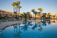 Swimming pool at a luxury caribbean, tropical resort, Tunisian Stock Photo