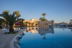 Swimming pool at a luxury caribbean, tropical resort, Tunisian Royalty Free Stock Image