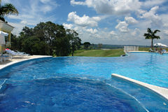 Swimming pool. Luxury swimming pool with cloudy blue sky Stock Images