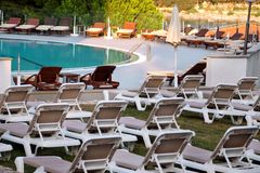 Swimming pool of luxury holiday hotel, amazing view and scene of seagull enjoying alone. Relax near pool with handrail, sunbeds. stock photos
