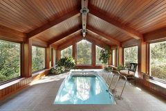 Swimming pool in luxury home royalty free stock image