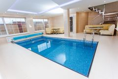 Swimming pool in luxury home Stock Image