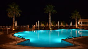 Swimming pool at the luxury hotel with blue color of water Royalty Free Stock Image