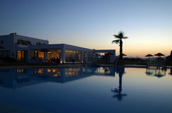 Swimming pool of luxury hotel at dusk Royalty Free Stock Image
