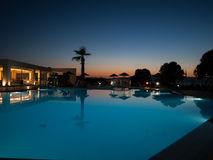 Swimming pool of luxury hotel at dusk Stock Photography