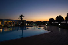 Swimming pool of luxury hotel at dusk Royalty Free Stock Photo