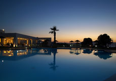 Swimming pool of luxury hotel at dusk Stock Photo