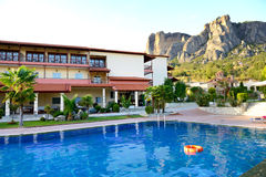 Swimming pool at the luxury hotel and Meteora mountains Royalty Free Stock Image