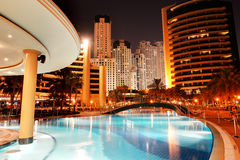 The swimming pool at luxury hotel in night illumination Royalty Free Stock Photos