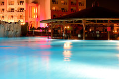 The swimming pool at luxury hotel in night illumination Royalty Free Stock Photography