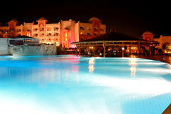 The swimming pool at luxury hotel in night illumination Stock Images