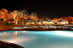 The swimming pool at luxury hotel in night illumination Royalty Free Stock Image