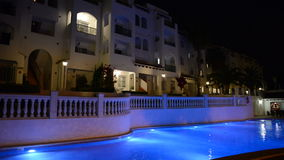 Swimming pool at the luxury hotel in night illumination stock video