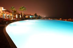 The swimming pool at luxury hotel in night illumination Stock Image