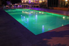 Swimming pool. Luxury hotel outdoor swimming pool at night Royalty Free Stock Photo