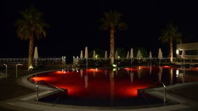 Swimming pool at the luxury hotel with red color of water stock video footage