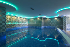 Swimming pool in luxury hotel spa center Stock Photos