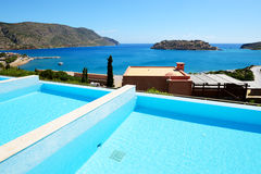 Swimming pool at luxury hotel with a view on Spinalonga Island Stock Image
