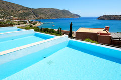Swimming pool at luxury hotel with a view on Spinalonga Stock Image