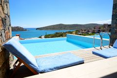 Swimming pool at luxury hotel with a view on Spinalonga Island Stock Photography