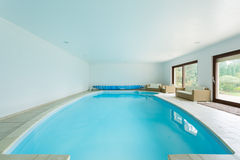 Swimming pool in luxury mansion Stock Image