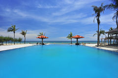 Swimming pool. Luxury swimming pool near the sea Royalty Free Stock Photography