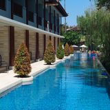 Swimming pool in luxury resort. Beautiful gardening with shadow Royalty Free Stock Images