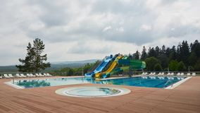 Swimming pool on luxury resort in forest. stock photography