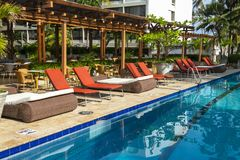 Luxury Resort Hotel Swimming Pool, Travel, Relaxing. Swimming pool at a luxury resort hotel. People like to relax when they travel on vacation or holiday stock image