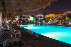 Swimming pool at luxury resort at night Stock Images