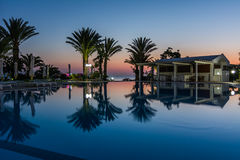 Swimming pool at a luxury resort at night, dawn time. Stock Image