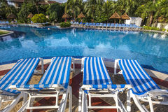 Swimming pool in luxury resort, Riviera Maya, Mexico. A view in CANCUN , MEXICO, DECEMBER 21, 2016 : Swimming pool in luxury resort hotel, december 21, 2016 in royalty free stock images
