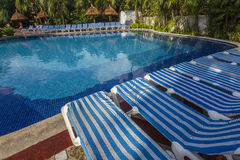 Swimming pool in luxury resort, Riviera Maya, Mexico. A view in CANCUN , MEXICO, DECEMBER 21, 2016 : Swimming pool in luxury resort hotel, december 21, 2016 in royalty free stock image