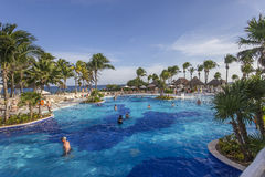 Swimming pool in luxury resort, Riviera Maya, Mexico. A view in CANCUN , MEXICO, DECEMBER 21, 2016 : Swimming pool in luxury resort hotel, december 21, 2016 in royalty free stock photos