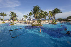 Swimming pool in luxury resort, Riviera Maya, Mexico. A view in CANCUN , MEXICO, DECEMBER 21, 2016 : Swimming pool in luxury resort hotel, december 21, 2016 in royalty free stock photography