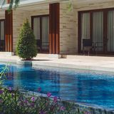Swimming pool in luxury resort. Beautiful gardening with shadow Royalty Free Stock Photos