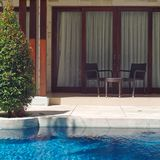 Swimming pool in luxury resort. Beautiful gardening with shadow Royalty Free Stock Photography