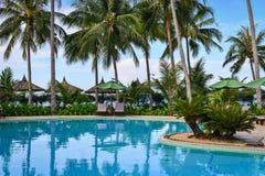 Swimming pool of luxury resort in Vietnam. Phan Thiet, Vietnam - Mar 26, 2017. Swimming pool with palm trees in Phan Thiet, Vietnam. Phan Thiet belongs to Binh Stock Image