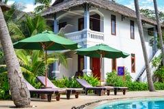 Swimming pool of luxury resort in Vietnam. Phan Thiet, Vietnam - Mar 26, 2017. Swimming pool with relaxing chairs in Phan Thiet, Vietnam. Phan Thiet belongs to Stock Image