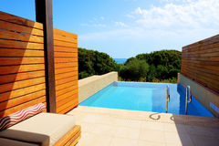 Swimming pool by luxury sea view villa Stock Photography