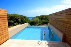 Swimming pool by luxury sea view villa Royalty Free Stock Photo