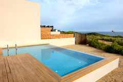 Swimming pool by luxury sea view villa Stock Photo