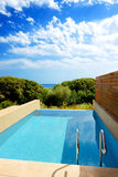 Swimming pool by luxury sea view villa Stock Photos
