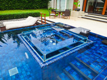 Swimming pool at luxury traditional villa Stock Photos