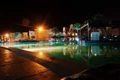 Swimming pool of a luxury tropical caribbean resort at night Stock Photography