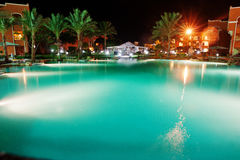Swimming pool of a luxury tropical caribbean resort at night Stock Images